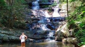 Wade Under A Waterfall Along The Emery Creek Falls Trail In Georgia