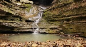 Hike Less Than A Mile To This Spectacular Waterfall Swimming Hole In Illinois
