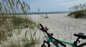 Walk Or Ride Alongside The Ocean On The 2.8-Mile Fort Macon Beach Trail In North Carolina