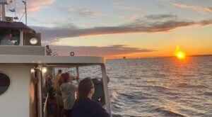 Step Aboard A Sip N' Sail Boat Cruise In Michigan To Enjoy Drinks And Sunset Views