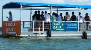 The Ultimate Party Boat Experience At Wisconsin's Floating Paddle Pub Lets You Pedal, Sip Beer, And Celebrate Summer