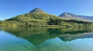 Climb High Up Into The Mountain Range To See This Alpine Lake Up Close In Alaska