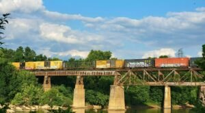 Watch Trains Roll Over The Trestle On A Casual Stroll Along The River In South Carolina