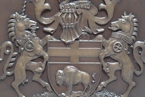 A crest is the object above the helmet on a coat of arms.