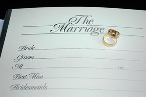 Blank marriage certificate with pair of gold bands.