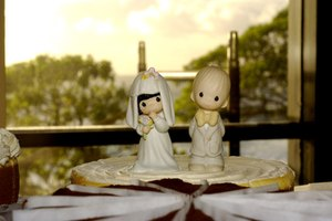 A cake topper featuring a bride and groom.