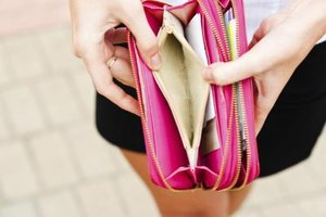 Close-up of woman opening empty wallet