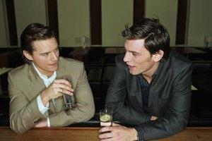 Two men talking at a bar.