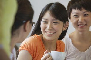 Smiling young woman talking to her friends.