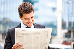 What Is the Difference Between an Editorial & a Newspaper Article?