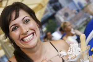 A woman forcing a smile in a restaurant.