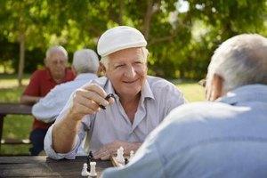 Senior man playing chess in park