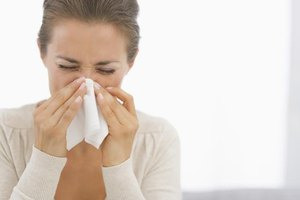 Woman sneezing in home