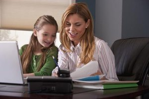 Mother helping her daughter with homework while dressed in business attire.
