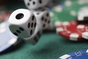 Close-up of dice and poker chips