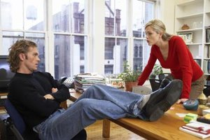 woman talking to boyfriend with feet on desk