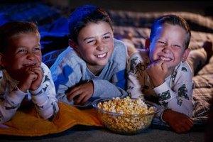 Children enjoy a movie party.
