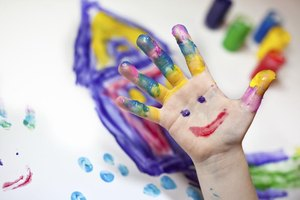 A young student fingerpainting.