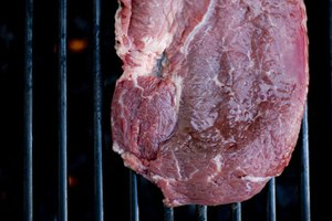 How to Grill a Steak to Medium Well on a Gas Grill