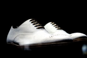 How to Remove Black Marks From White Leather Shoes