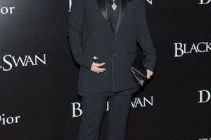 Winona Ryder wears a menswear-inspired suit.