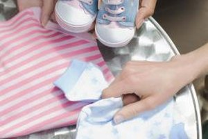 Gift her baby clothes in the newborn size and in a larger size.