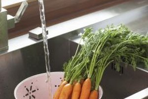 In addition to killing microorganisms on the surface, blanching also brightens the carrots' color.
