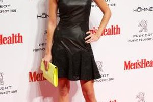Spanish actress Clara Lago pairs her black dress with a yellow clutch at an event in Madrid in October 2013.