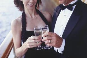 A summer black-tie event might mean a sleeveless cocktail dress for women, and a lightweight tuxedo for men.