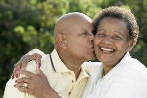 Husband kissing his wife outside.