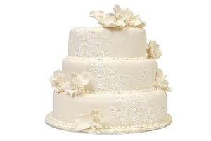 Brush embroidery highlights the floral theme of a wedding cake.