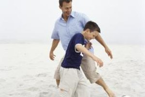 Spending time together and good communication promote a healthy father-son relationship.