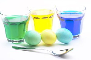 Liquid food coloring and water tint egg whites almost any color.