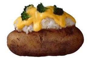 Add toppings such as broccoli and cheese after baking a large potato.