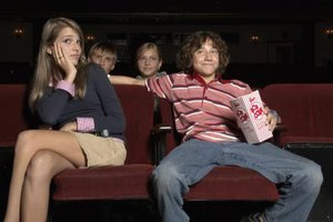 Going to the movies together may send the impression that you are interested in dating.