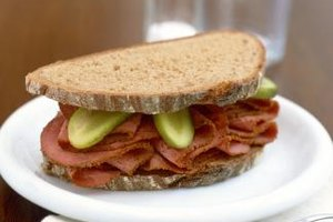 Pickles, mustard and onions are classic garnishes for pastrami sandwiches.