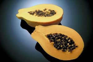 Eat peppery, nutritious papaya seeds, or add them to salads.