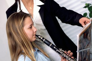 What Are the Positive & Negative Effects of Music for Kids in School?