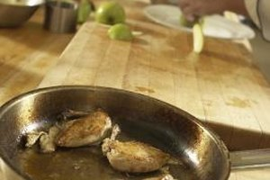 Purchase boneless chicken parts or debone a whole chicken yourself before dicing.