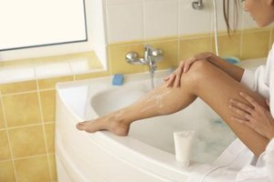 You might find it easier to shave the tops of your legs when you're sitting down.