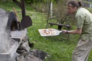 A pizza paddle prevents burns when baking in a clay oven.