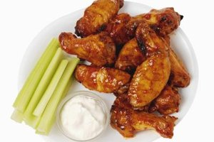 Fry wings and dip them in a hot sauce, honey and butter mixture to make buffalo wings.