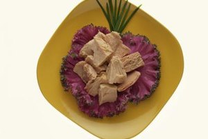 Tuna on a bed of veggies is a low-fat source of protein, fiber and vitamins.