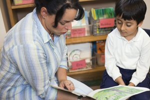 Kindergarten teachers help struggling readers with phonics and comprehension skills.