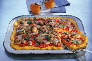 Spread an even layer of thick polenta and top it as you would a pizza.