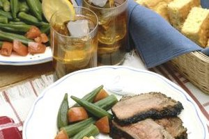 Serve London broil with vegetables and bread for a well-rounded meal.