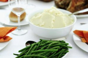 Mashed potatoes and green beans are classic sides for a rib roast.