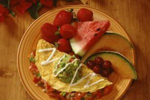 Pair egg white omelets with fresh fruit and vegetables for a low-cal breakfast.