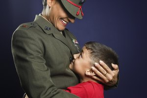 United States Marine hugging son