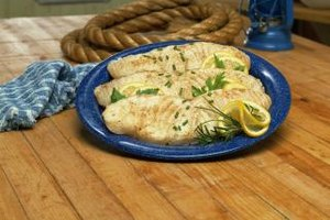 Bake halibut fillets in foil packets for a quick, flavorful meal.